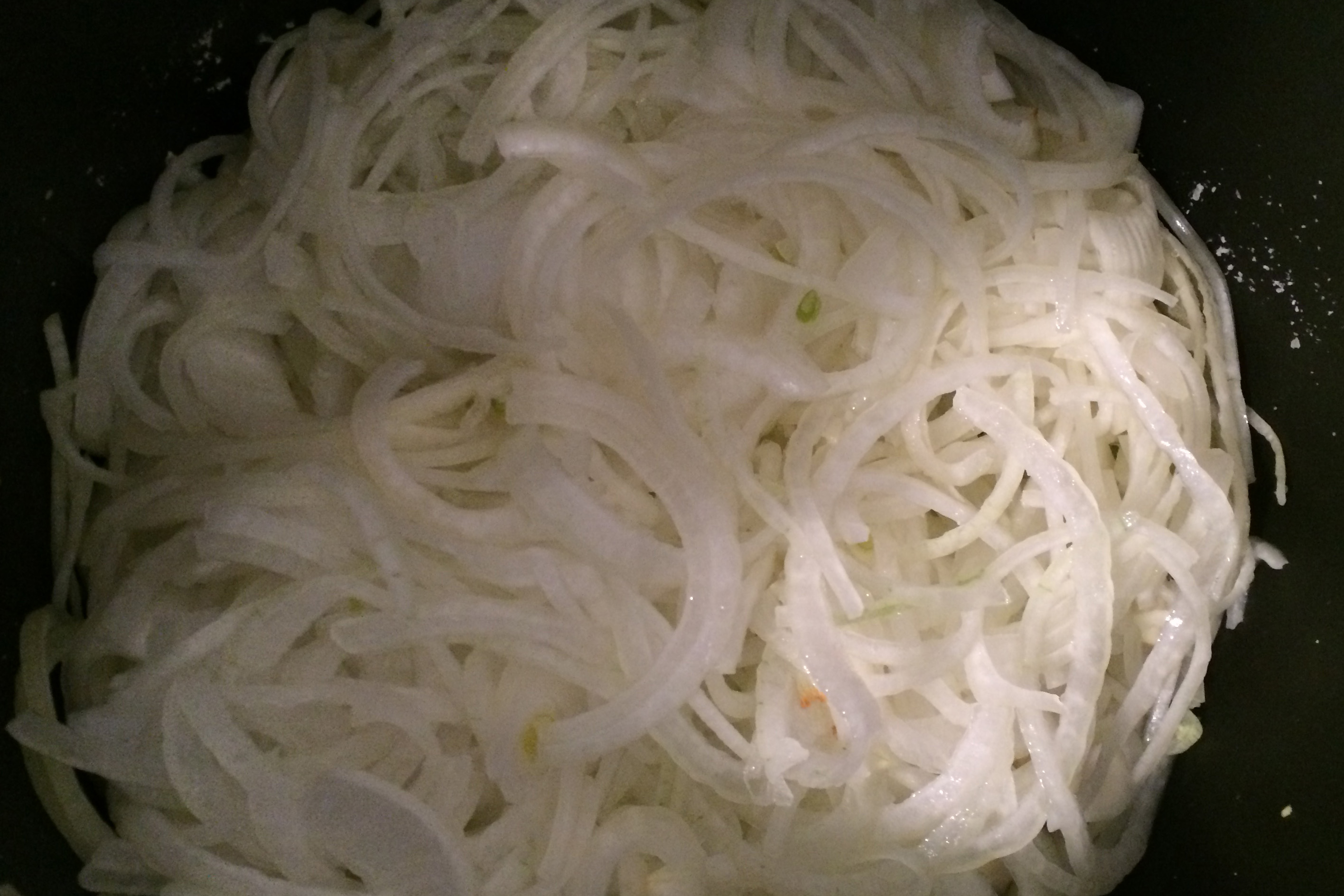 Sliced onions in crockpot